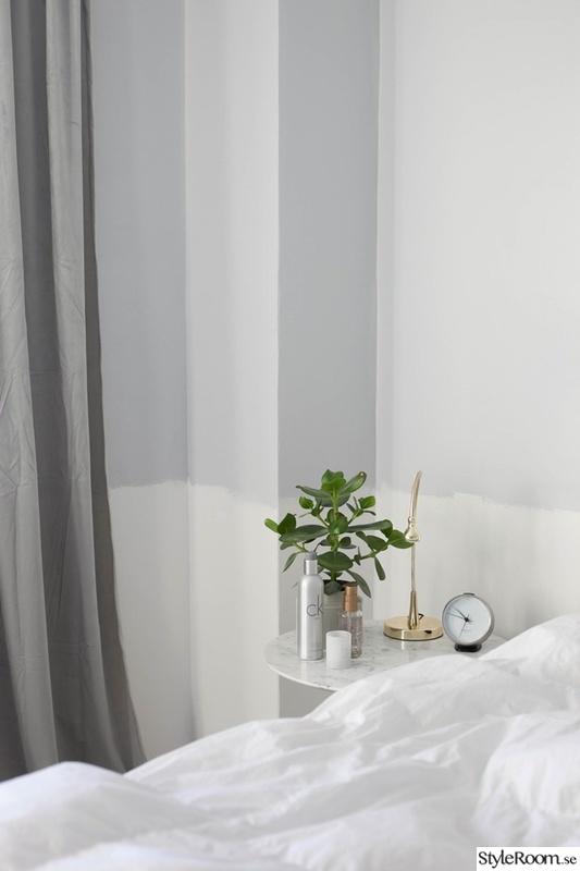 sängbord i marmor i sovrum