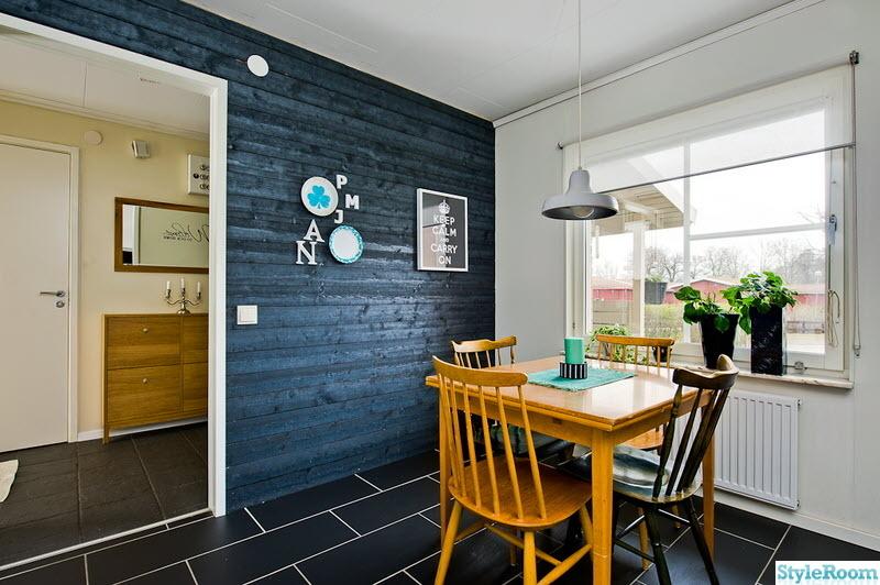 panelvägg,svart klinker,matplats,svart,kök