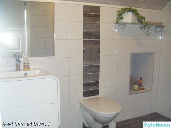 svedbergs style,vägghängd toalett,klinker trä,kakel vitt