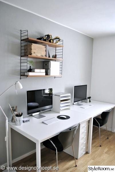 Hemma kontor med skrivbord för mac