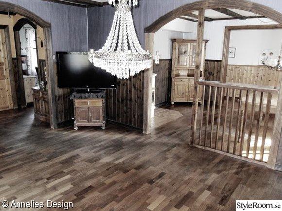 före och efterbilder,renovering,mörkt trä,brunlaserad panel,vardagsrum